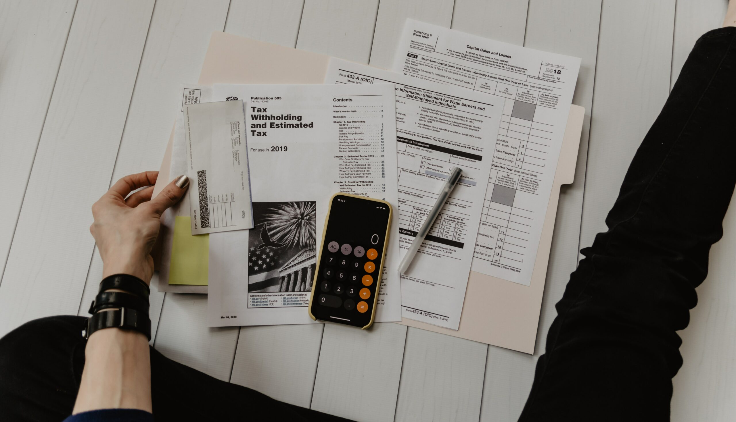 Man sitting on the floor with his papers to file taxes